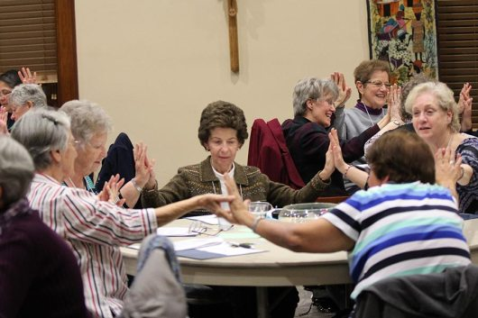 Sisters of Providence and Providence Associates on retreat, including Providence Associate Yvonne Conniff, center, used hand motion, song and togetherness to enter more deeply into their prayer during the retreat.